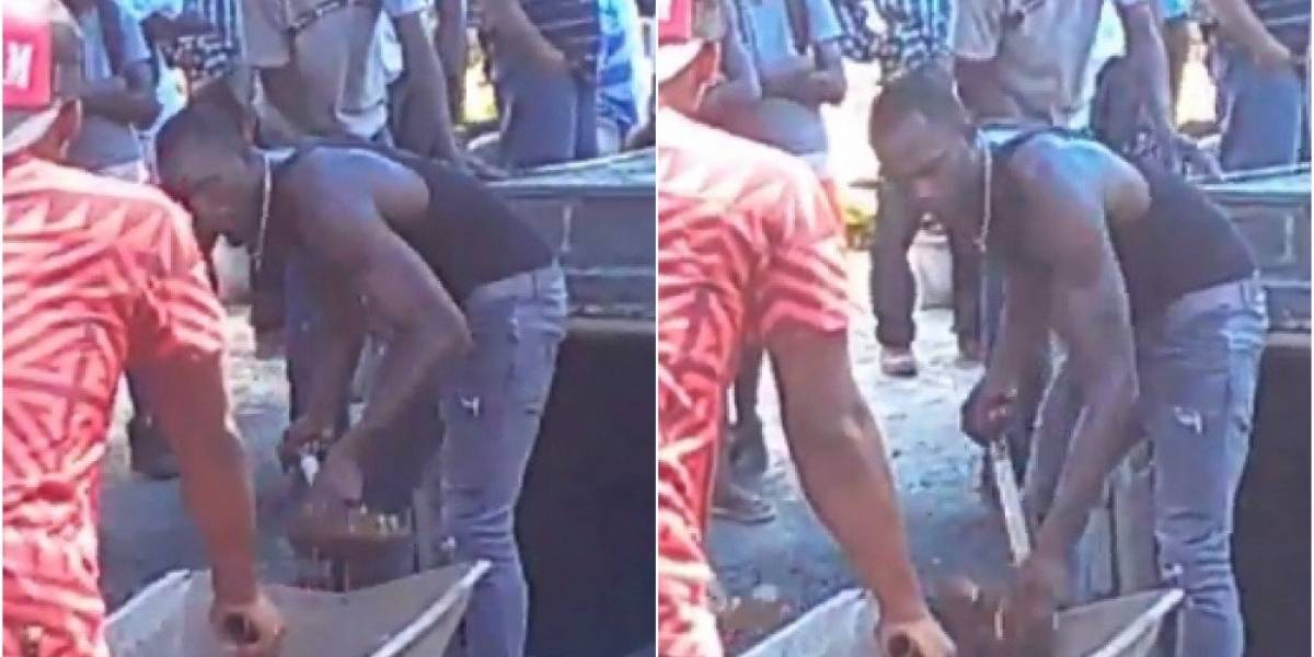 Usain Bolt cava la tumba de su amigo Germaine Mason, muerto en accidente