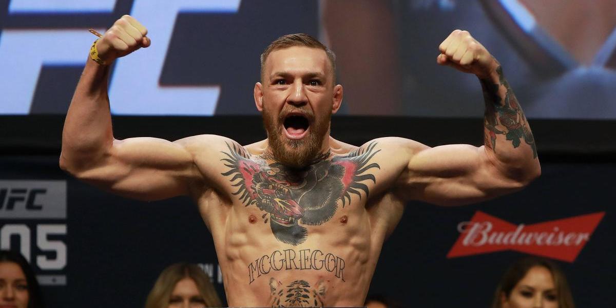 Conor McGregor firma precontrato millonario para pelear con Floyd Mayweather Jr