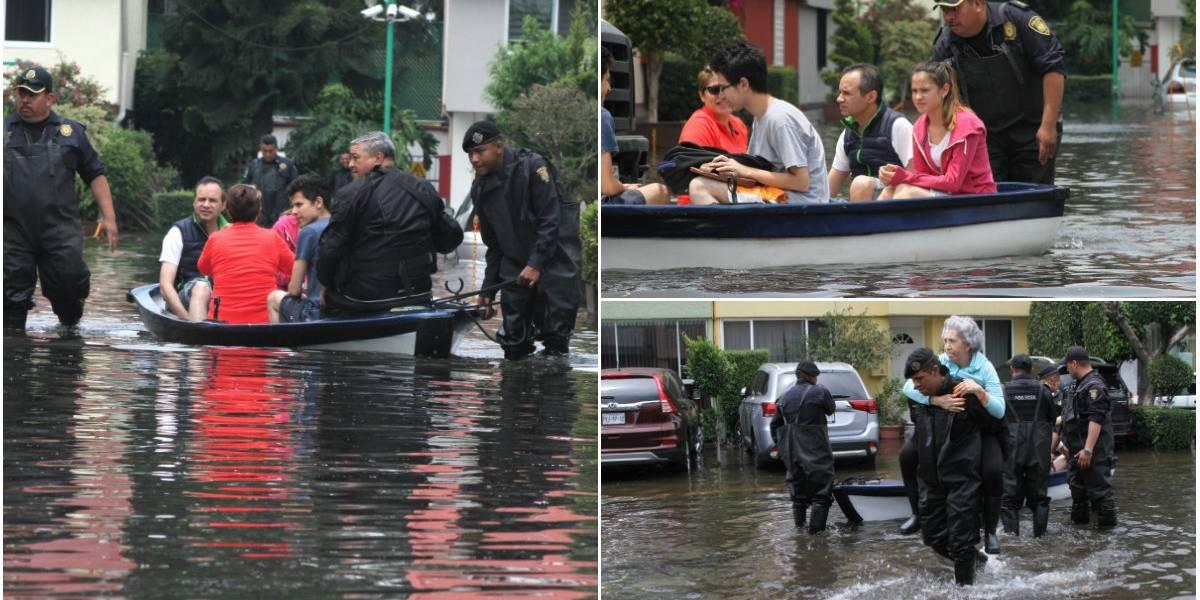 """VIDEO: Vecinos se mueven en lanchas por los """"canales"""" de Coapa"""