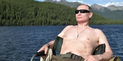 Putin pesca con el torso desnudo en las montañas de Siberia