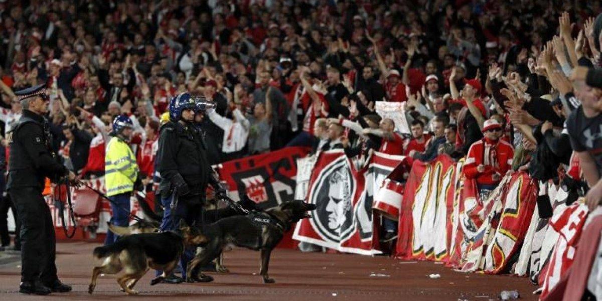 Arsenal teme las penas del infierno y Wenger alega inocencia por incidentes de los hinchas del Colonia