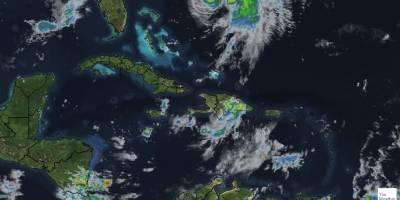 Siguen los aguaceros sobre RD debidos a vaguada y onda tropical