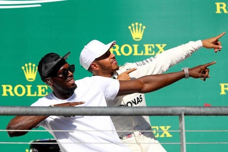 Usain Bolt junto a Lewis Hamilton