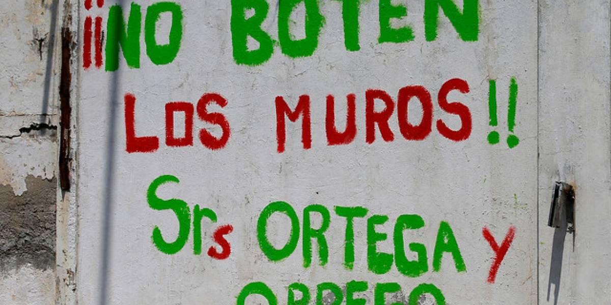 La Legua: enfrentamientos entre vecinos y Carabineros por derribo de muros deja a siete personas detenidas