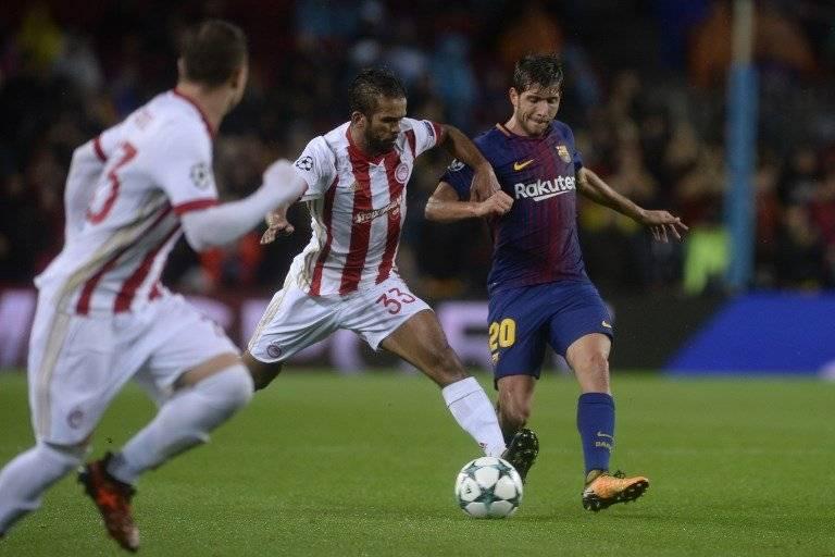 Acción de un partido entre Barcelona y Olympiacos