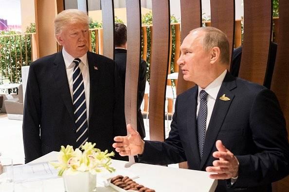 Donald Trump y Valdimir Putin, durante la cumbre del G20 en Hamburgo, en 2017.