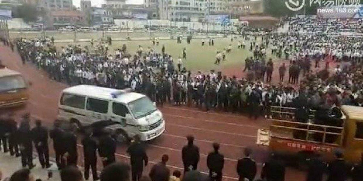 Execução pública de condenados chineses reúne multidão de pessoas