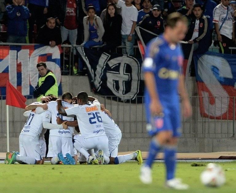 El festejo de Cruzeiro en el Nacional ante la U el 3 de abril de 2014 / Foto: AFP