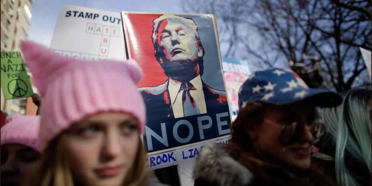 Decenas de miles en marcha contra Trump en aniversario de su presidencia