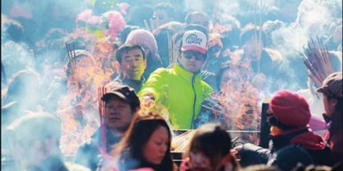 Un templo budista chino lanza servicio para enviar bendiciones por SMS