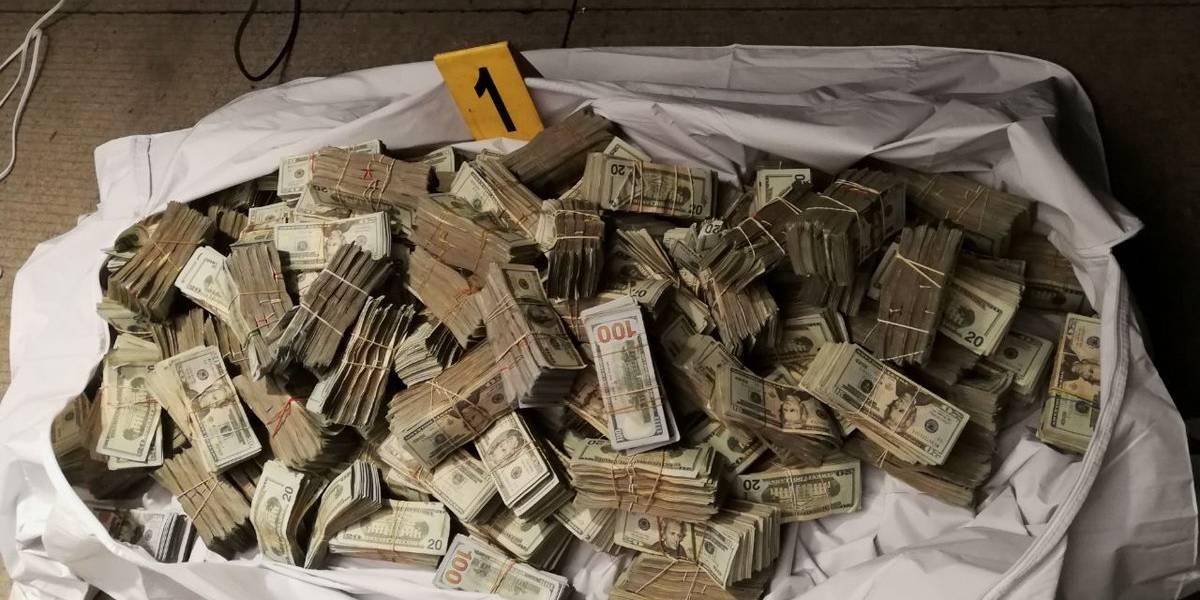 Localizan más de 1 millón de dólares en efectivo ocultos en tráiler en Quiché