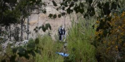 Localizan cadáver de mujer entre matorrales en Mixco