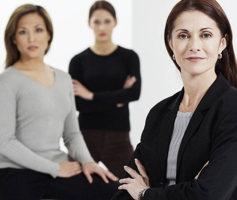 Confident Businesswoman with Her Associates