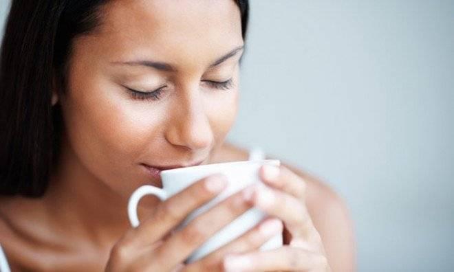 womandrinkingcoffeetheguardian1660x550.jpg