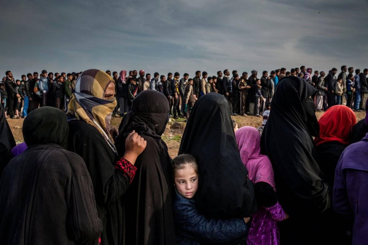 Categoria Foto do Ano: civis restantes na cidade de Mossul, no Iraque, aguardam em fila para receber suprimentos de emergência Ivor Prickett, for The New York Times/World Press Photo
