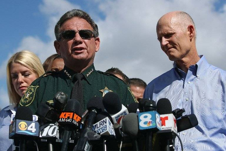 Scott Israel y Rick Scott