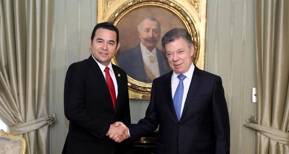 Jimmy Morales y Juan Manuel Santos