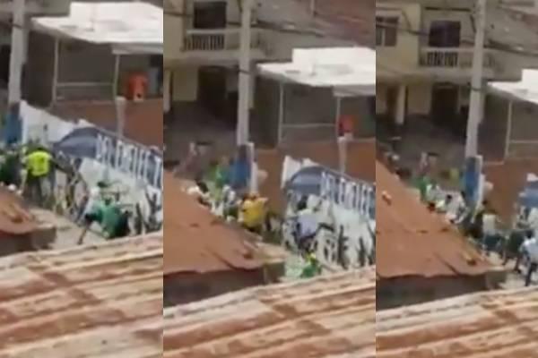 Hinchas de Atlético Nacional tumbaron a golpes mural de Emelec