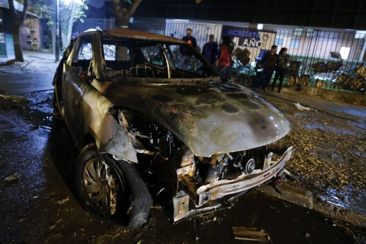 Vehículos quemados en Macul