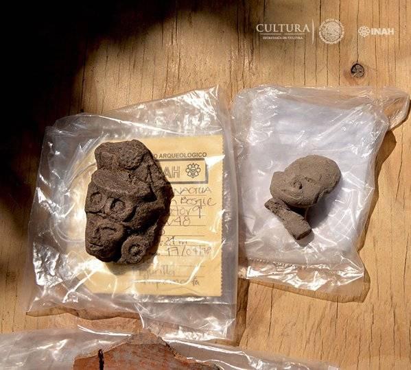 Figurillas y restos de cerámica, se ha fechado para el periodo Preclásico (1500 a.C. a 300 d.C.). Foto: Melitón Tapia, INAH.