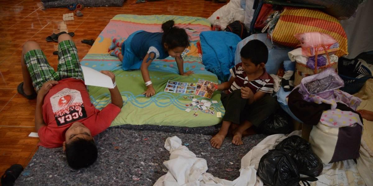 EN IMÁGENES. Familias albergan esperanzas ante tragedia del volcán de Fuego