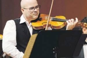 Omar Velázquez, violinista. fe