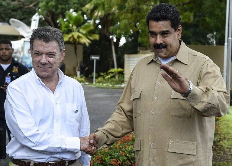 Juan Manuel Santos y Nicolás Maduro