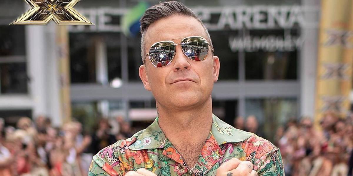 Robbie Williams sobre ser novo jurado do 'The X Factor': 'Vim pelo dinheiro'