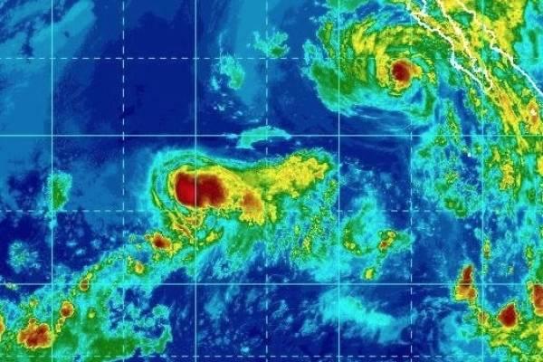 John pierde fuerza y avanza frente a costa mexicana como tormenta