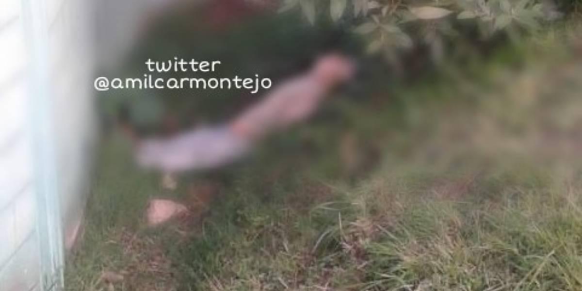 Localizan a hombre fallecido en avenida Las Américas; hay un arma de fuego a su lado