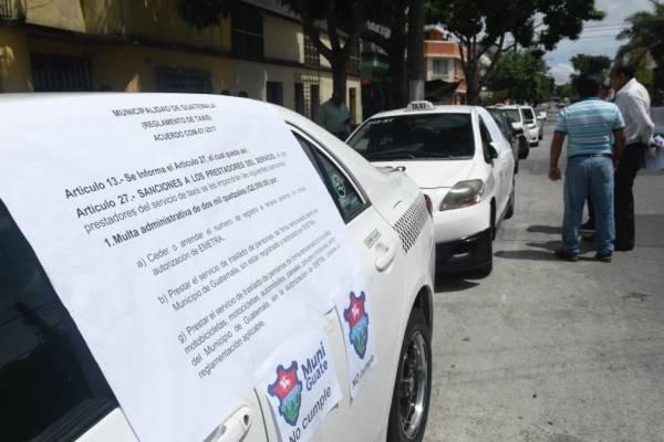Taxistas se oponen a la operación de Uber en Guatemala.