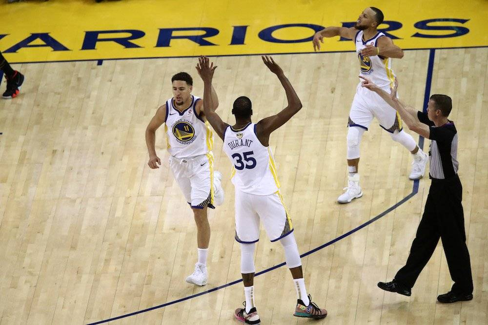 Kevin Durant, Klay Thompson, Stephen Curry / Getty Images
