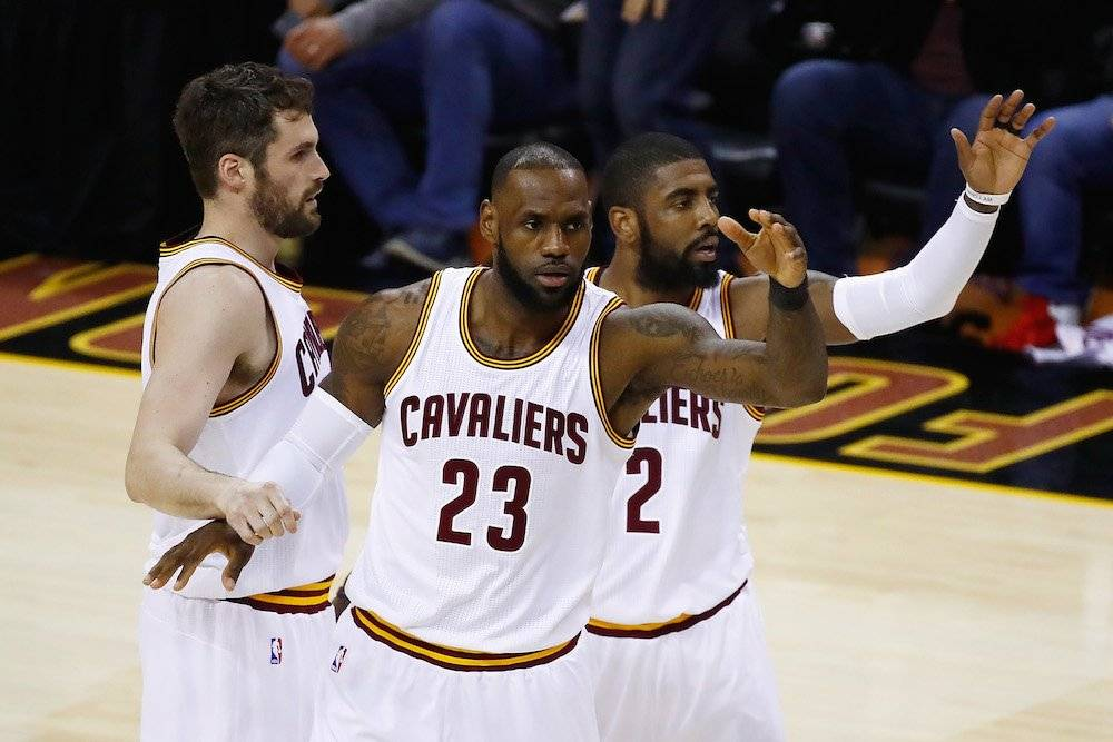Kevin Love, LeBron James, Kyrie Irving / Getty Images