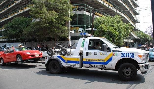 Las grúas en la capital del país ya no te pueden infraccionar. Cortesía.