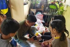 Regala botas de hule a niños