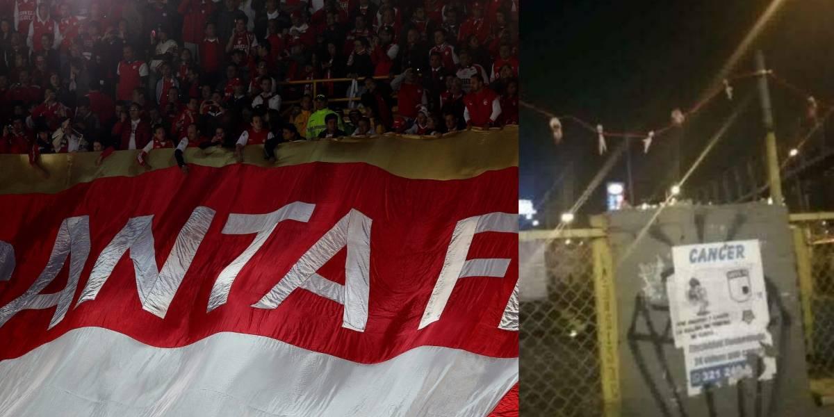 La escalofriante 'cargada' de barras bravas de Santa Fe contra Millonarios