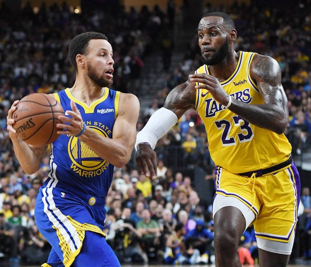 Stephen Curry y LeBron James ahora se enfrentarán en la misma conferencia del Oeste. / Getty Images