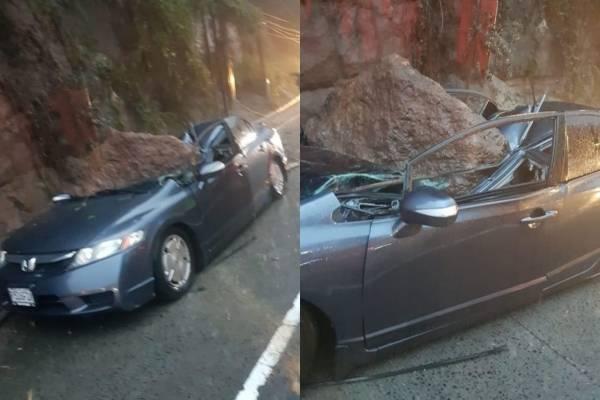 Roca cae sobre carro