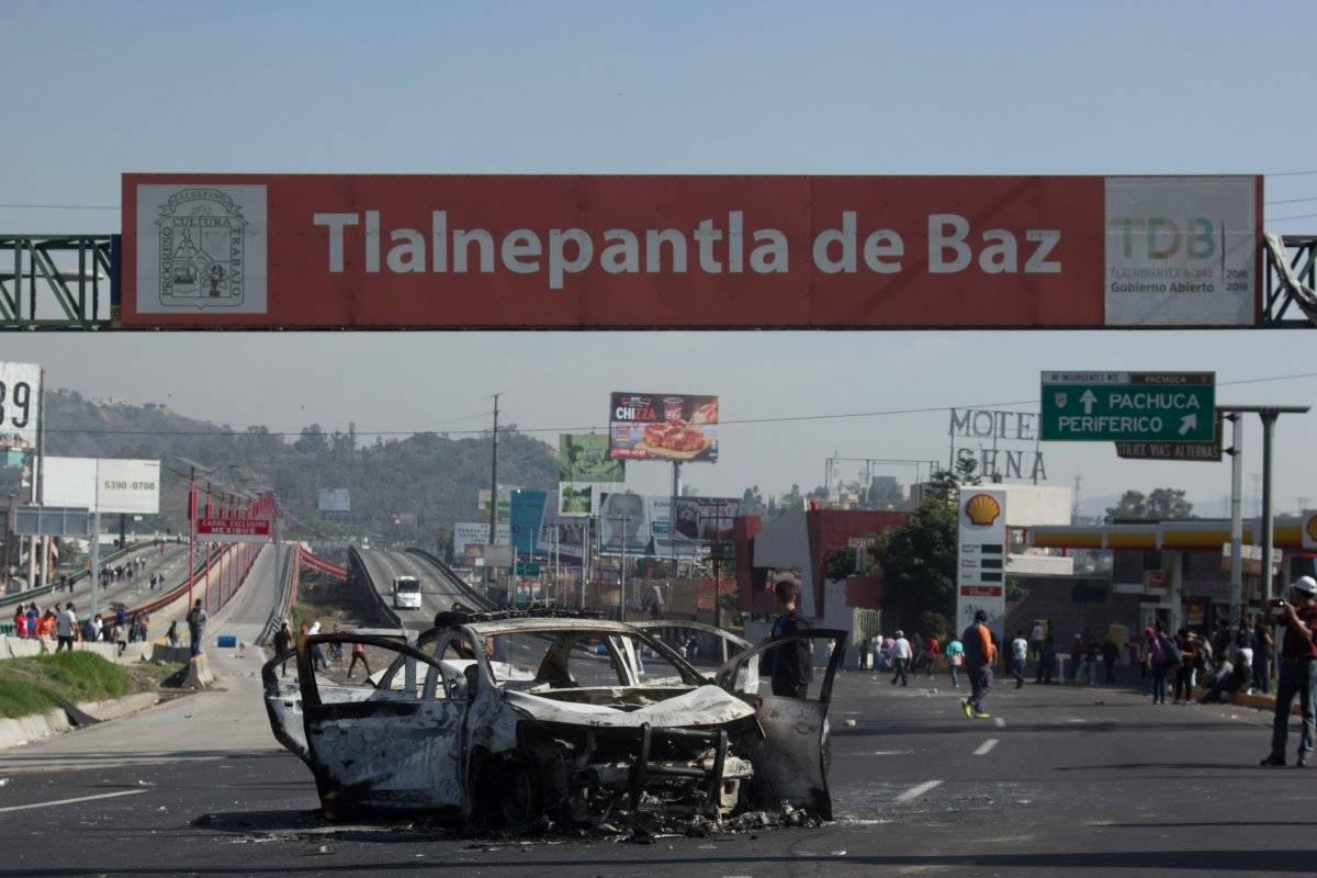 Incendian patrulla en San Juanico Foto: Cuartoscuro