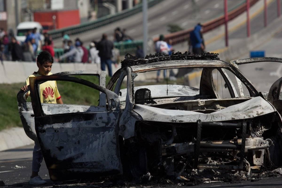 Fueron incendiados 6 vehículos. Foto: Cuartoscuro