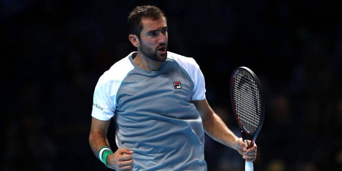 Cilic derrotó a Isner y clasificó a Djokovic a las semis de las Finales de la ATP