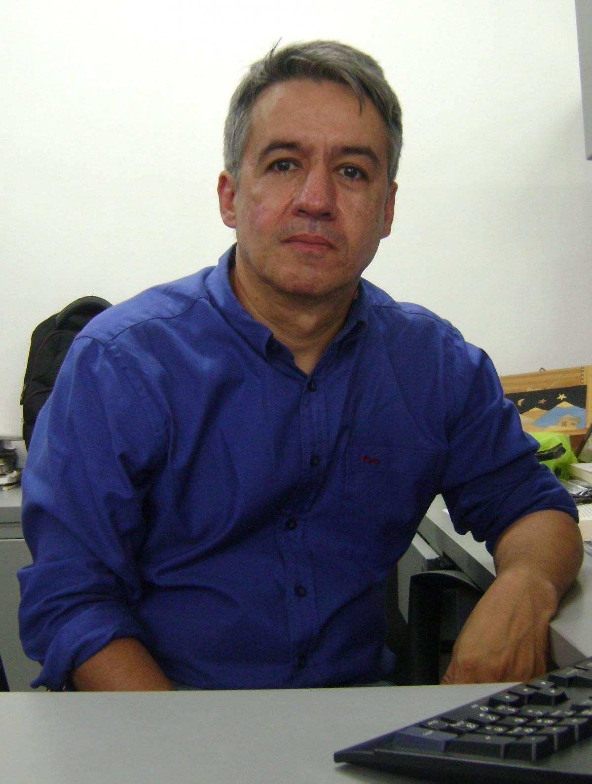 Juan Carlos Escobar, Politólogo