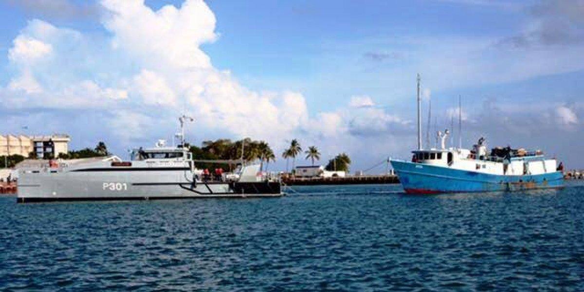 Regresan al país tres de los 176 pescadores detenidos en Bahamas