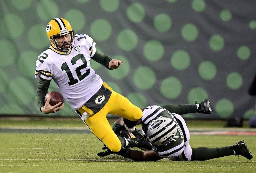 Packers 44-38 Jets / Getty Images