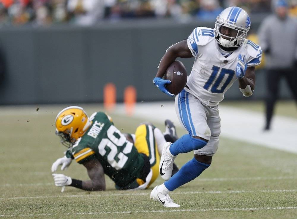 Lions 31-0 Packers / AP