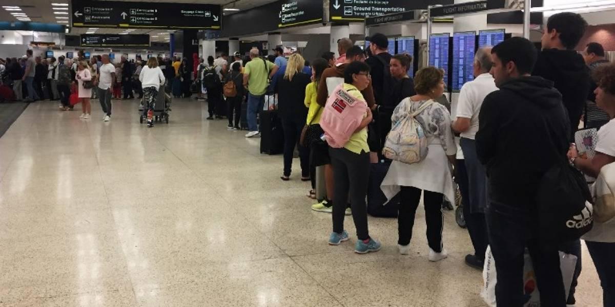 Largas filas en aeropuerto de Miami por cierre del gobierno de EE. UU.