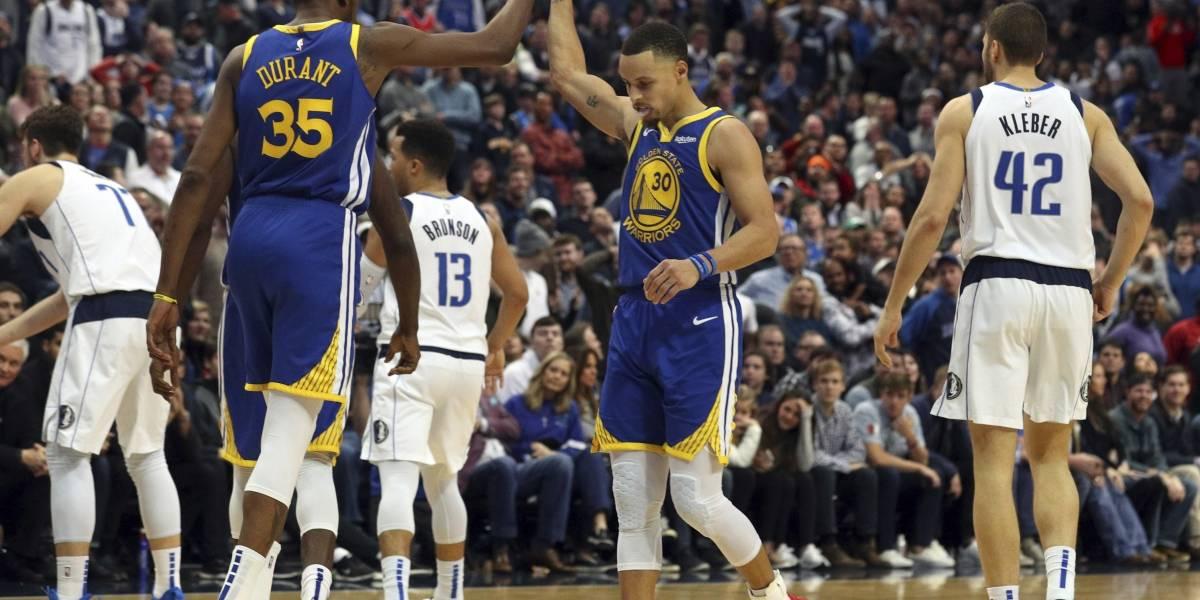 Warriors vencen a los Mavericks en partido bien cerrado