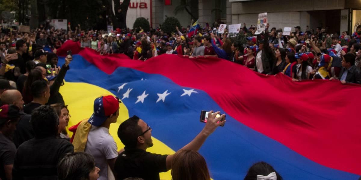 Llaman México y Uruguay a reunión mundial para resolver el caso Venezuela