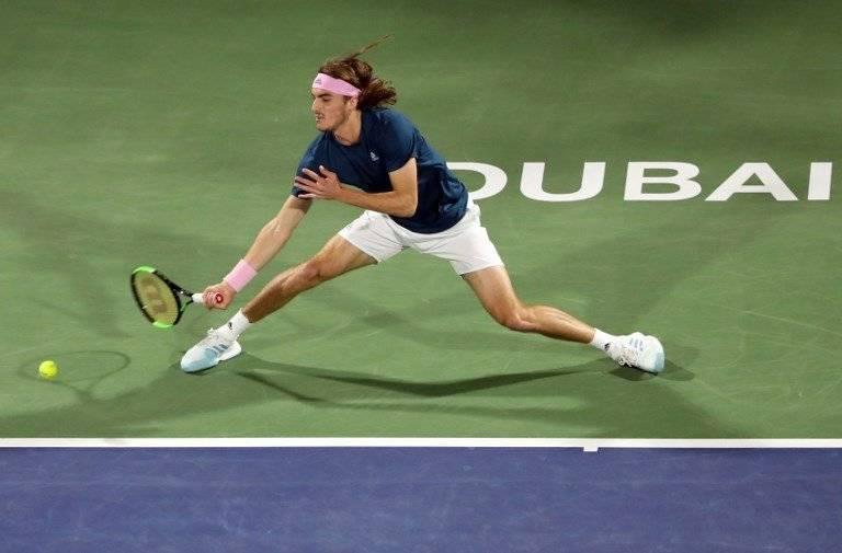 Federer gana su título cien