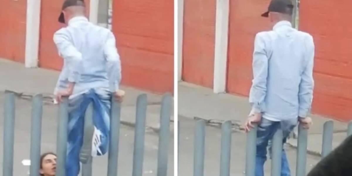 Por ahorrarse unos pasos, joven quedó atrapado en tubos separadores de TM y casi se queda sin pantalón